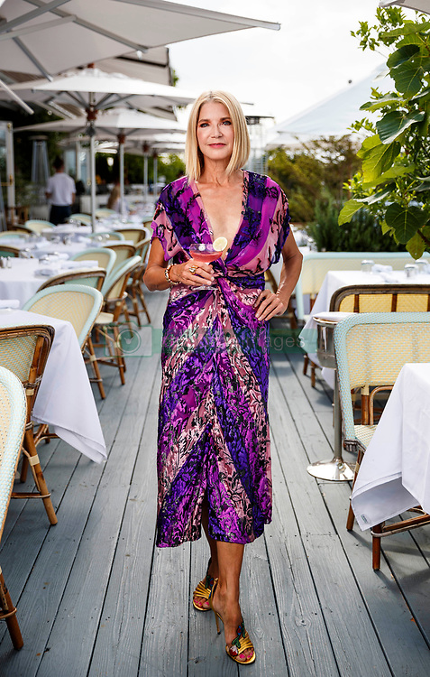 EXCLUSIVE: Candace Bushnell, author of Sex and the City, is pictured around Sag Harbor on July 2, 2019 where she features some of her favorite places including Canio's Bookstore, Bilboquet restaurant and Morris Cove. **NO NEW YORK DAILY NEWS, NO NEW YORK TIMES, NO NEWSDAY**. 02 Jul 2019 Pictured: At Bilboquet restaurant. Photo credit: Annie Wermiel/NY Post / MEGA TheMegaAgency.com +1 888 505 6342