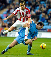 Photo: Ed Godden.<br />Coventry City v Stoke City. Coca Cola Championship. 02/12/2006. Stoke's Lee Hendrie (L) colides with Clive Clarke.