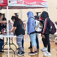 Staff members work quickly as students lined up in the rain for the Tasty Shack who showed up to the University of New Mexico-Gallup campus. The Robertson's handed out free ice cream to the students in Gallup, New Mexico.