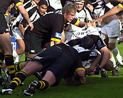 Wycombe. GREAT BRITAIN, 10th October 2004, Guinness Premiership Rugby, London Wasps and Newcastle Falcons, Adams Park, ENGLAND. [Mandatory Credit; Pete Spurrier/Intersport-images]<br /> <br /> Falcons Stuart Grimes applies the downward pressure on Colin Charvis to score a try for Newcastle Falcons.