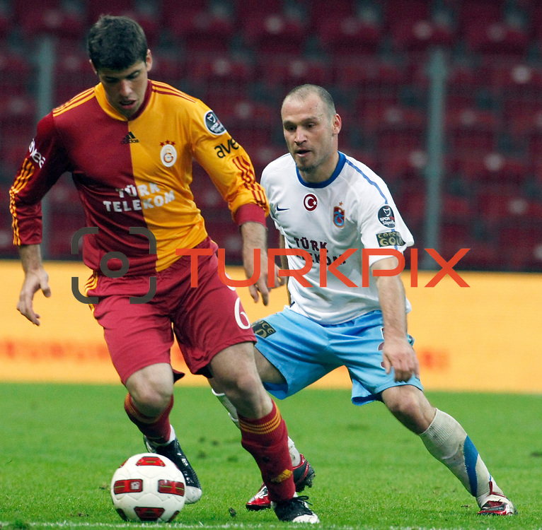 Galatasaray's Emiliano INSUA (L) and Trabzonspor's Serkan BALCI (R) during their Turkish superleague soccer derby match Galatasaray between Trabzonspor at the TT Arena in Istanbul Turkey on Sunday, 10 April 2011. Photo by TURKPIX