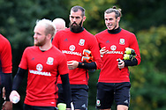 Gareth Bale of Wales ® chats to Joe Ledley of Wales © as they arrive for  the Wales football team training at the Vale Resort in Hensol, near Cardiff , South Wales on Tuesday 29th August 2017.  the team are preparing for their FIFA World Cup qualifier home to Austria this weekend.  pic by Andrew Orchard, Andrew Orchard sports photography
