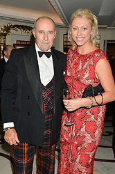 LT.GEN.SIR GRAEME LAMB and his daughter EMILY LAMB granddaughter of David Shepherd at the David Shepherd Wildlife Foundation 30th anniversary Wildlife Ball at The Dorchester, Park Lane, London on 10th October 2014.