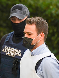© Licensed to London News Pictures. 22/06/2021. Athens, Greece. Babis Anagnostopoulos leaves the court escorted by police in Athens. The 33-year-old helicopter pilot and flight instructor Babis Anagnostopoulos has been detained as a suspect in the murder of his British wife Caroline Crouch, 20, outside Athens last month after publicly claiming she'd been killed during a brutal invasion of the couple's home, police said. Photo credit: Ioannis Alexopoulos/LNP