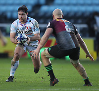 Henry Chavancy  of Racing 92 takes on Tom Lawday of Harlequins