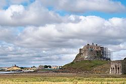 Lindisfarne Castle partially clad in scaffolding as it undergoes major restoration works. Holy Island, Northumberland, England, UK<br /> Photo: Ed Maynard<br /> 07976 239803<br /> www.edmaynard.com