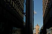 Tower Bridge between buildings seen from South Bank, London, England, UK