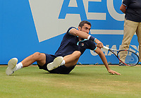 Tennis - 2017 Aegon Championships [Queen's Club Championship] - Day Six, Saturday<br /> <br /> Men's Singles, Semi Finals<br /> Marin Cliic [Croatia] vs. Gilles Muller [Lux]<br /> <br /> Marin Cliic slips on the grass on Centre Court <br /> <br /> COLORSPORT/ANDREW COWIE
