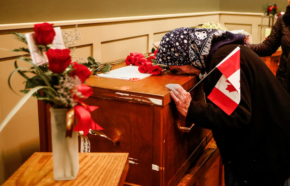 A woman from the Kurdish community pays her respects to John Gallagher, a Canadian volunteer fighter and former Canadian forces member who was killed fighting alongside Kurdish forces in Syria against the Islamic State, in Blenheim, Ontario, Canada, November 20, 2015.