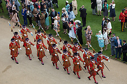 Yeoman Warders parade as guests attend a garden party at Buckingham Palace in London.