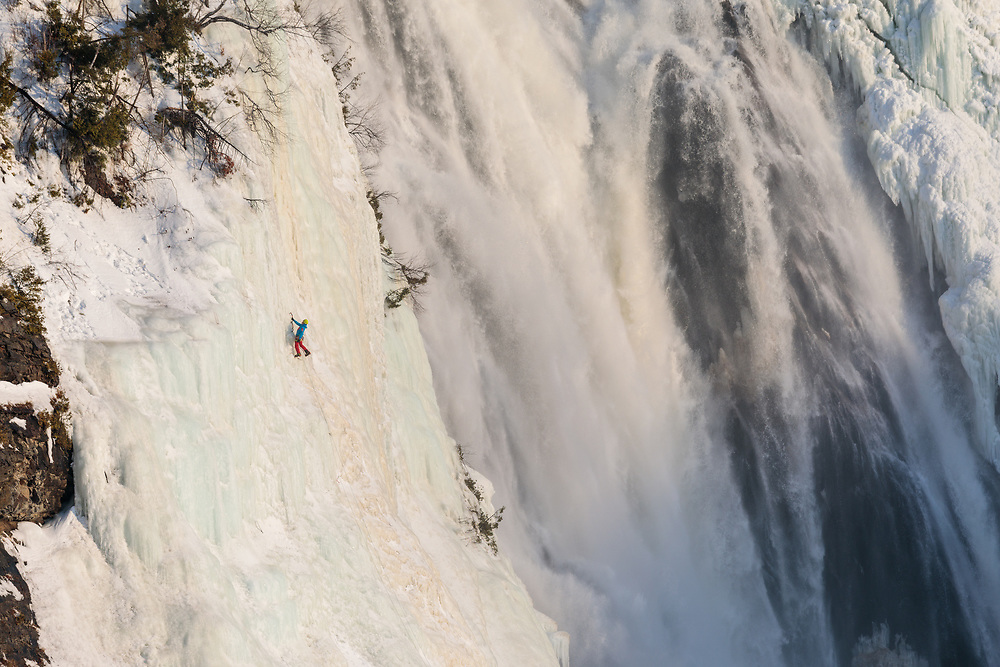 Etienne Rancourt climbing Piller Crystal, WI4+, Chutes Montmorency in Quebec City, Quebec