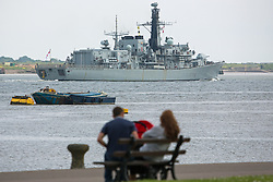 © Licensed to London News Pictures. 16/05/2016. HMS Kent seen from Gravesend Prom in Kent. The Type-23 frigate HMS Kent has left London after a short stay to head towards commemorative events to mark the centenary of the Battle of Jutland. She leaves London for Rosyth, a major port and key ship building area of the First World War, where she will take part in events organized by the Scottish Government at South Queensferry. She will then sail for Scapa Flow where she will provide a gun salute. Credit : Rob Powell/LNP