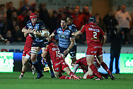 Seb Davies  of Cardiff Blues © is stopped by Steff Evans and Leigh Halfpenny ® of the Scarlets. Guinness Pro14 rugby match, Scarlets v Cardiff Blues  at the Parc y Scarlets in Llanelli, West Wales on Saturday 28th October 2017.<br /> pic by  Andrew Orchard, Andrew Orchard sports photography.