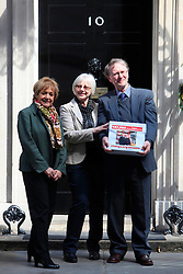 © Licensed to London News Pictures 24/04/2013.Bookshop owners Keith and Frances Smith, along with Margaret Hodges MP (left), hand in a petition of over 157,000 signatures to Downing Street, challenging Amazon over its reduced payment of UK corporate tax. .London, UK.Photo credit: Anna Branthwaite/LNP