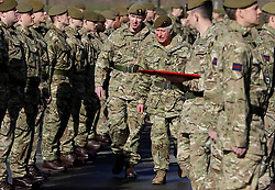 The Prince of Wales (centre right), Colonel Welsh Guards, presents campaign medals to soldiers from the 1st Battalion Welsh Guards at Elizabeth Barracks, Pirbright Camp in Woking, following their return from Afghanistan.