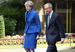 Prime Minister Theresa May, accompanied by her husband Philip, before making a statement in Downing Street after she traveled to Buckingham Palace for an audience with Queen Elizabeth II following the General Election results.