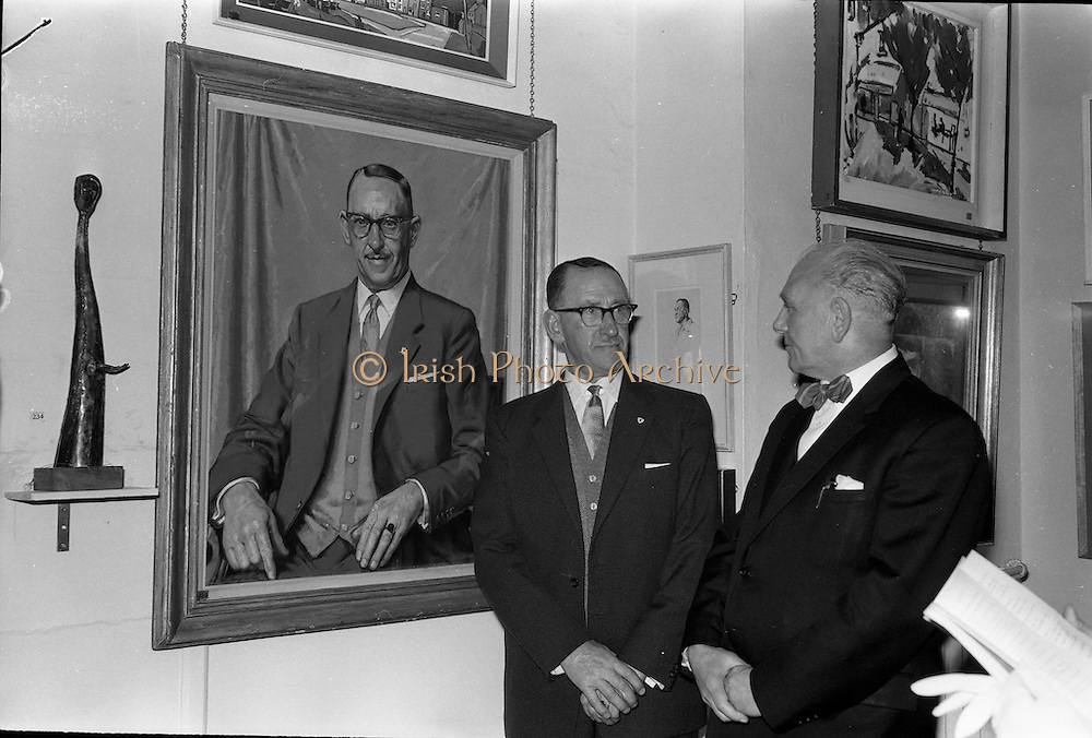 06/05/1963<br /> 05/06/1963<br /> 06 May 1963<br /> Opening of the RHA exhibition at the National College of Art, Dublin. It was the 134th exhibition of the Academy. Image shows Mr William J. Stapleton of 81 Frankfort Avenue, Rathgar, in front of his portrait by the artist George Collie, RHA. Mr Stapleton was a senior executive with Bord na Mona for 23 years and held the position of Advertising Manager and Public Relations Officer at the time of his retirement in July 1962. At this time he was a Director of  Ostanna Iompair Éireann, the CIE Hotels subsidiary company. On right is Dr. Ivor Holloway, Superintendent of the Regional Maternity Hospital, Limerick.
