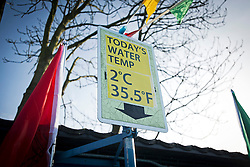 ©  London News Pictures. 26/01/2013. London, UK. A board displaying the water temperature atthe Cold Water Swimming Championships at Tooting Bec Lido in South London on January 26, 2013. The biannual event sees some competitors dress in costume. Photo credit: Ben Cawthra/LNP