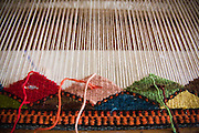 A wool rug in process on a loom at the Chavez family workshop in Teotitlan del Valle, Oaxaca state, Mexico on July 29, 2008. The Zapotec town is famous for carpet weaving, the better artists producing high quality work using natural dyes and drawing from both traditional and contemporary designs.