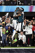 Philadelphia Eagles rookie running back Corey Clement (30) and Philadelphia Eagles running back Jay Ajayi (36) leap in the air as they celebrate after Clement catches a 22 yard touchdown pass good for a 29-19 third quarter Eagles lead during the 2018 NFL Super Bowl LII football game against the New England Patriots on Sunday, Feb. 4, 2018 in Minneapolis. The Eagles won the game 41-33. (©Paul Anthony Spinelli)