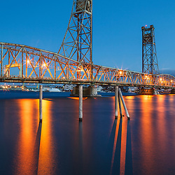 Lights reflect in the Pisctaqua River below the Memorial Bridge in Portsmouth, New Hampshire.