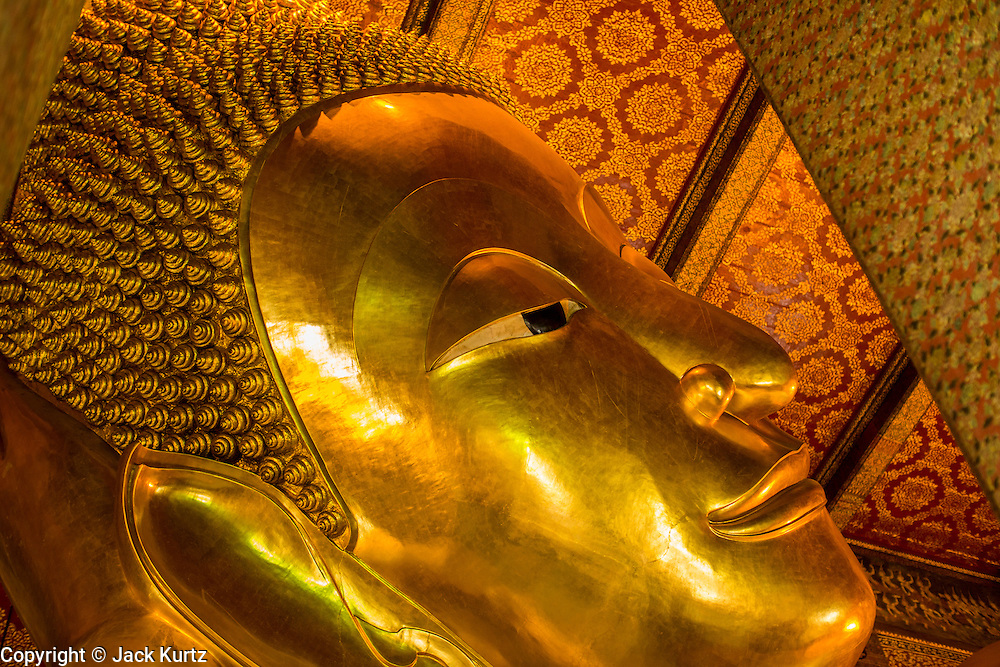 26 NOVEMBER 2012 - BANGKOK, THAILAND:  The head of the Reclining Buddha at Wat Pho in Bangkok. Thailand's Temple of the Reclining Buddha has gained further global prominence following a 45-minute tour by U.S. President Barack Obama and Secretary of State Hillary Clinton during their November 18-19 visit to the kingdom. Known also as the Temple of the Reclining Buddha, its official name is Wat Phra Chettuphon Wimon Mangkhlaram Ratchaworamahawihan. The temple is also known as the birthplace of traditional Thai massage. There is a popular massage school on the temple grounds.    PHOTO BY JACK KURTZ