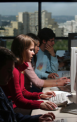 PARIS -  FRANCE - APRIL-21-2004 - Male and female students work in a university computer lab. <br />