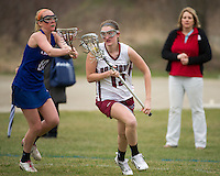Londonderry's Chelsea Lewis guards Concord's Grace Orzechowski during Tuesday's NHIAA Division I Lacrosse.  (Karen Bobotas/for the Concord Monitor)