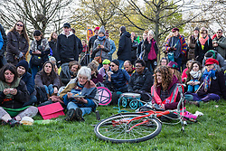 London, UK. 14th April 2019. Climate campaigners from Extinction Rebellion, some of whom had walked from as far away as Land's End on the 'Earth March', gather in Hyde Park to prepare for 'International Rebellion UK - Shut Down London!' events next week to call on the Government to take urgent action to address climate change.