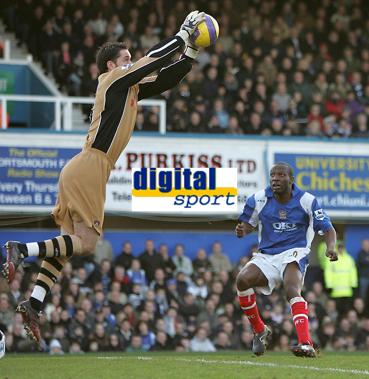 Photo: Lee Earle.<br /> Portsmouth v Charlton Athletic. The Barclays Premiership. 20/01/2007. Pompey's new signing Lauren (R) watches as Charlton keeper Scott Carson collects the ball.