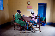 Sarah Mallia speaks with Rose a HIV positive patient at the VCT center at the Nimule Hospital. Rose helped start the hospital's HIV support group.