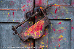 Lock on temple doors on a walk through Nuwakot on Motorcycle Sherpa's Ride to the Heavens motorcycle adventure in the Himalayas of Nepal. This first day of riding took us from Kathmandu to Nuwakot. Monday, November 4, 2019. Photography ©2019 Michael Lichter.