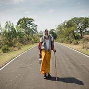 I met Deepak Sunita, a lone pilgrim, in Madyah Pradesh. He carries holy water from the Narmada River in his tin. Life can be simple.<br /> A Hindu pilgrim circumambulating the holy Naramda river.<br /> Madhya Pradesh Province.