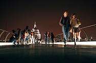 Millennium Bridge and the St. Paul's Cathedral at night. London, United Kingdom.
