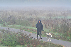 © Licensed to London News Pictures 20/10/2018<br /> SIDCUP,UK.<br /> Early morning dog walker.<br /> A cold autumnal mist at Footscray Meadows this morning in Sidcup.<br /> Photo credit: Grant Falvey/LNP