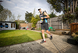 © Licensed to London News Pictures. 11/04/2020. Stoneleigh, UK. Kevin Webber completes the last equivalent Stage of the Marathon des Sables ultramarathon in his Surrey garden during lockdown. Kevin has run the entire 230Km (143 miles) 6 stage race in his small back and front gardens, completing 2734 laps, over 6 days - finishing today. Kevin, who was diagnosed with terminal prostate cancer just over 5 years ago was due to take part in his 5th consecutive running of what is described as the 'toughest foot race on Earth' through the Sahara Desert in Southern Morocco this month, but the 2020 six day race has been postponed until September.  Kevin is raising funds for the National Emergencies Trust Coronavirus Appeal who will distribute the funds to where they are needed most in the UK and he will jointly split what he raises with Prostate Cancer UK. Photo credit: Peter Macdiarmid/LNP
