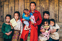 A family with their vaccination cards at the JE vaccination campaign in Khon Kahndone Village, Xieng Khouang province, Laos.