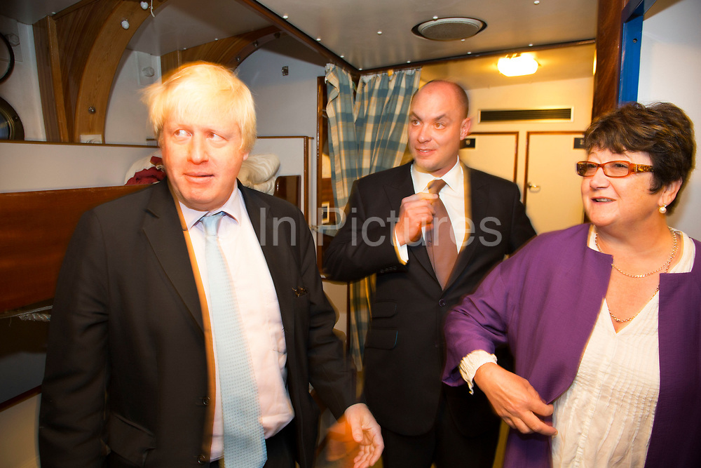 London, UK. Monday 8th September 2014. London Mayor Boris Johnson meeting with crew members during a visit to Royal Greenwich Tall Ships Festival which is organized by RB Greenwich, aboard the vessel TS Tenacious. The Festival is included as a highlight of Totally Thames, the new month-long promotion of river and riverside events delivered by Thames Festival Trust.