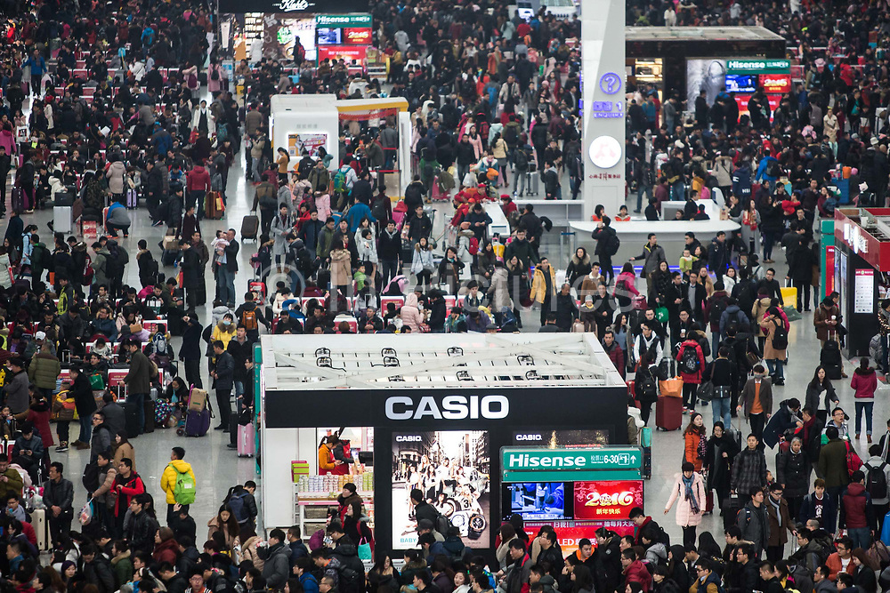 Passengers crowd into the Hongqiao Highspeed Railway Station during the Chinese New Year travel rush in Shanghai, China, on Feb. 5, 2016.