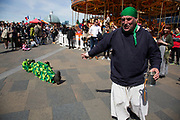 May Day custom of Deptford Jack in the Green, a man encased in a framework entirely covered with greenery, is one of the lesser-known modern revivals by the Blackheath Morris Men of English traditional customs on May 1st 2016 in London, United Kingdom. A short play aobut the Jack is acted out. Fowlers Troop Jack in the Green was revived in the early 1980s. Originally a revival from about 1906, it developed from the 17th Century custom of milkmaids going out on May Day with the utensils of their trade, decorated with garlands of flowers and piled into a pyramid which they carried on their heads. By the mid eighteenth century other groups, notably chimney sweeps, were moving in on the milkmaids territory as they saw May Day as a good opportunity to collect money, so carried a Jack in the Green. Over the last 25 years several popular festivals have grown up around the Jack in the Green tradition. Deptford Jack in the Green is not very widely known although it has been running since the early 1980s.
