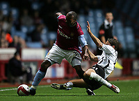 Photo: Lee Earle.<br /> Aston Villa v Fulham. The Barclays Premiership. 21/10/2006. Fulham's Michael Brown (R) slides in on Didier Agathe.