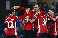 Zlatan Ibrahimovic of Manchester United (c) celebrates with his teammates after he scores his teams first goal.  Premier league match, Everton v Manchester United at Goodison Park in Liverpool, Merseyside on Sunday 4th December 2016.<br /> pic by Chris Stading, Andrew Orchard sports photography.