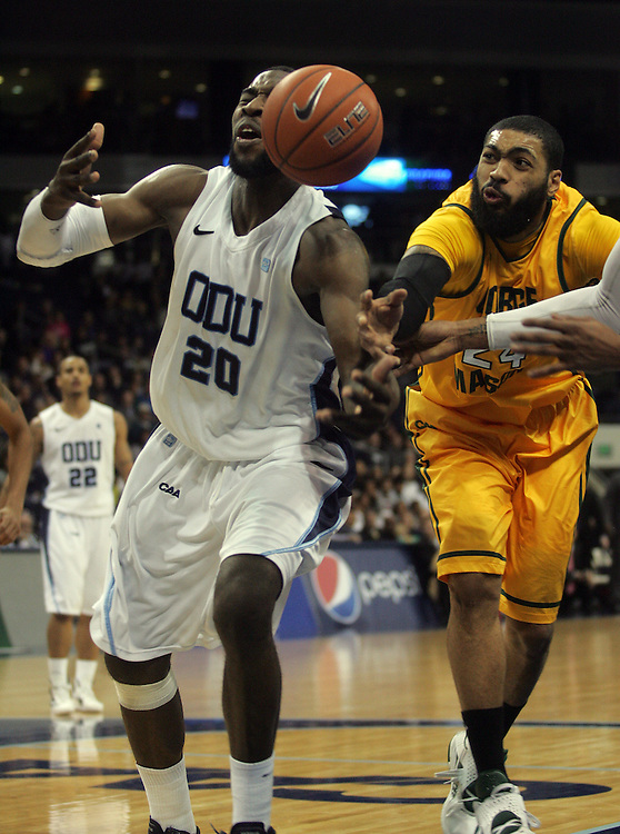 Jan 5, 2012; Norfolk, VA, USA; Old Dominion Monarchs forward Chris Cooper (20) and George Mason Patriots forward Ryan Pearson (24) battle for the ball at the Ted Constant Convocation Center. Mandatory Credit: Peter Casey-US PRESSWIRE