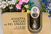 ITA_050923_29_rwx.Cemetery in Radicofani, Italy (near Pienza) with photos on a gravestone..