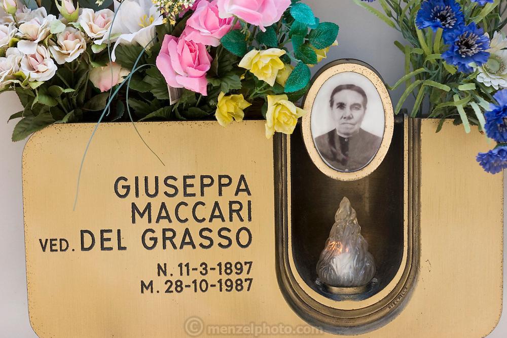 ITA_050923_29_rwx.Cemetery in Radicofani, Italy (near Pienza) with photos on a gravestone..