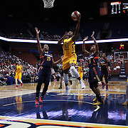 UNCASVILLE, CONNECTICUT- JUNE 5:   Shenise Johnson #42 of the Indiana Fever goes to the basket for two points past Alyssa Thomas #25 of the Connecticut Sun and Jasmine Thomas #5 of the Connecticut Sun during the Indiana Fever Vs Connecticut Sun, WNBA regular season game at Mohegan Sun Arena on June 3, 2016 in Uncasville, Connecticut. (Photo by Tim Clayton/Corbis via Getty Images)