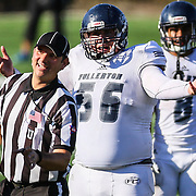 11/5/2016 - Fullerton Hornet offensive lineman Nathan Trent (56) protests a call made during the game against Orange Coast College - Costa Mesa, CA.<br /> <br /> ©2016 Jayme Spoolstra/Sports Shooter Academy