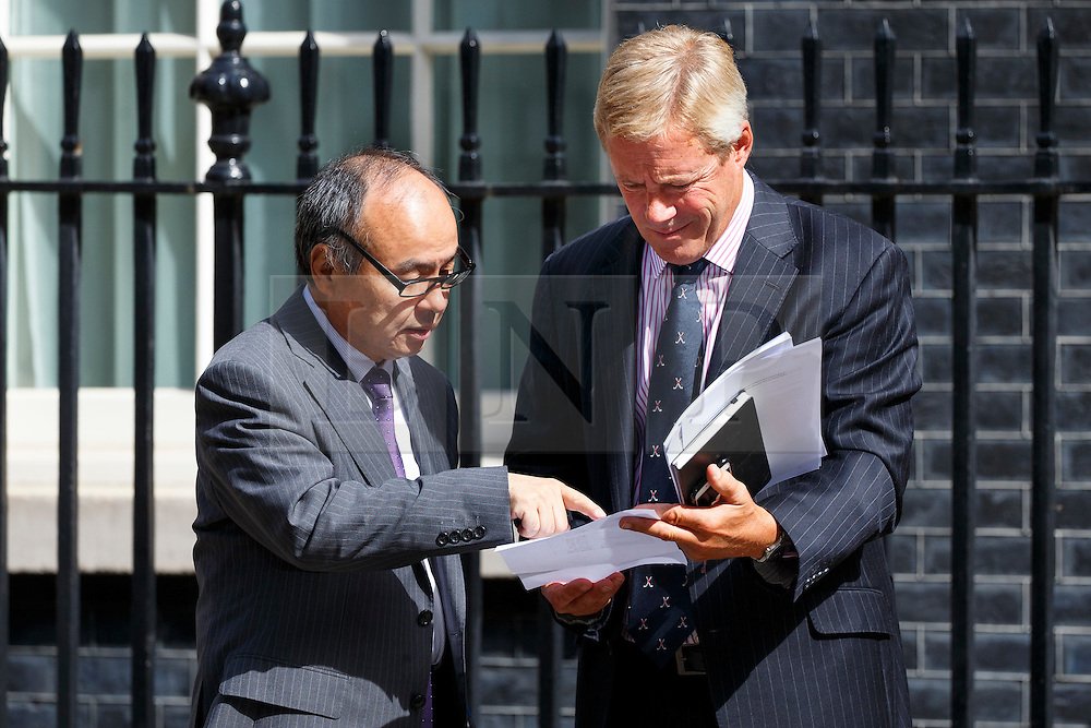 © Licensed to London News Pictures. 18/07/2016. London, UK. CEO of SoftBank, MASAYOSHI SON and Chairman of ARM Holdings, STUART CHAMBERS meet at No 11, Downing Street on Monday, 18 July 2016. The UK technology firm ARM Holdings is to be bought by Japan's Softbank for £24bn. Photo credit: Tolga Akmen/LNP