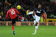 Antonio Valencia of Man Utd ® challenges Cardiff's Fraizer Campbell. Barclays Premier League match, Cardiff city v Manchester Utd at the Cardiff city stadium in Cardiff, South Wales on Sunday 24th Nov 2013. pic by Andrew Orchard, Andrew Orchard sports photography,