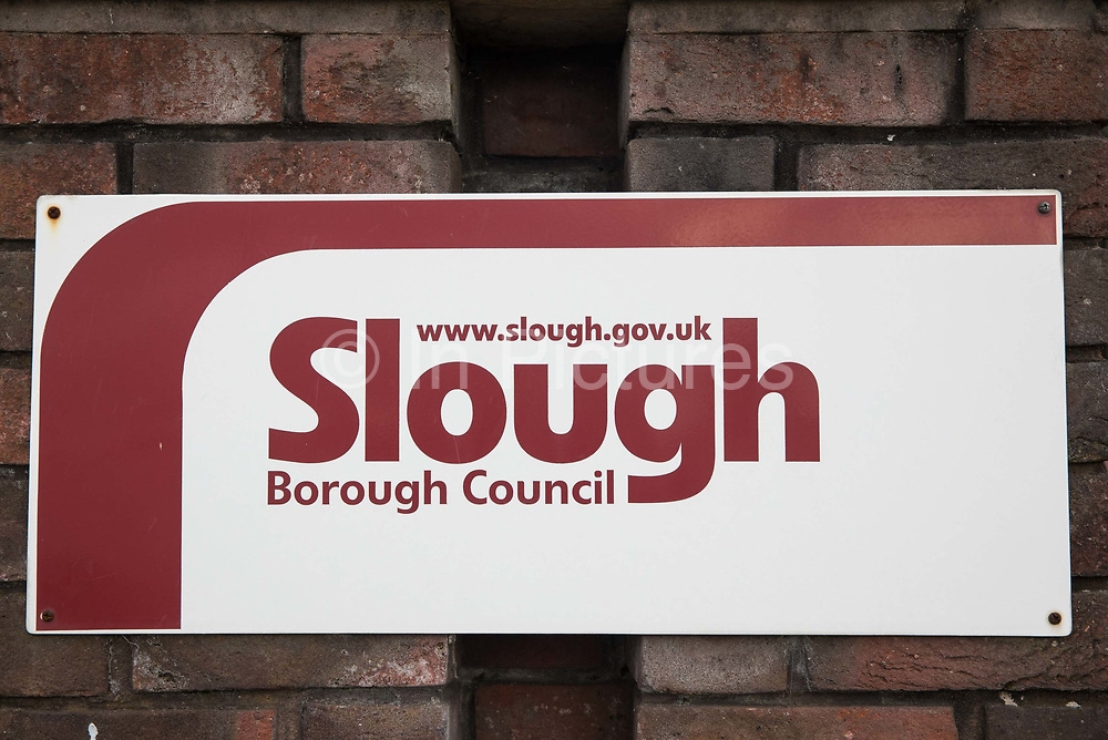 A sign outside Slough Borough Council offices is pictured on 23 October 2020 in Slough, United Kingdom. The Government has announced that Slough will change its COVID Alert Level status from Tier 1 Medium Alert to Tier 2 High Alert with effect from 00:01 on Saturday 24 October following a sustained rise in COVID-19 cases resulting in an infection rate of 153 cases per 100,000.